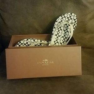 White and black coach flip-flops